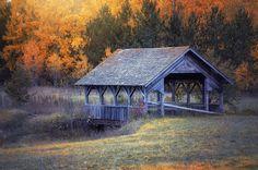 Covered bridge in autumn (Minnesota) by Karen Hunnicutt