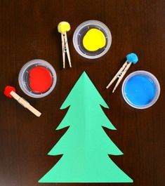 Create a Christmas Tree craft using a simple painting with pom poms technique. It's a great toddler craft. Create a Christmas Tree craft using a simple painting with pom poms technique. It's a great toddler craft. Christmas Tree Painting, Christmas Tree Crafts, Christmas Themes, Santa Crafts, Xmas Tree, Christmas Crafts For Kindergarteners, Simple Christmas, Christmas Christmas, Decorations Christmas