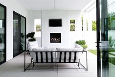 Home Tour: Black, White & Badass on apartment 34 Zen, Lush, Villa, Minimal Decor, Cool House Designs, Upholstered Furniture, Outdoor Spaces, Outdoor Living, Outdoor Chairs