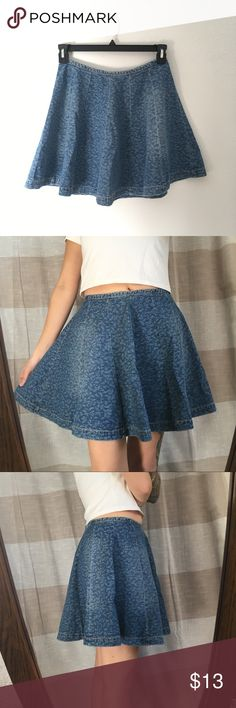 """Denim Skater Skirt Full skater skirt. Blue jean denim with little leaf pattern. Medium weight but not very stiff, this one flows beautifully. Back hidden zipper. Labeled a Medium but I'm listing it as a small. I'm a size 4 and it fits me great. Measurements laying flat: waist 13.5"""", length 16.5"""". In good used condition, some wear along waist. Brand is L'Amour by Nanette Lepore Nanette Lepore Skirts Mini"""