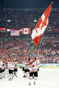 Sidney Crosby  87 of Canada waves a national flag following his team s 3-1. Hockey  GamesHockey ... 03cd365e1