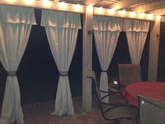 Love my new patio makeover with painters tarp curtains!