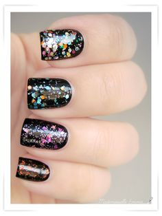 Black base with different glitter on each nail. Simple and cute!
