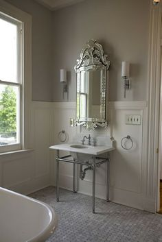 Isn't it amazing how one gorgeous mirror can make a space?!