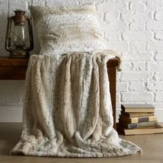 Introduce a stylish, warm and cosy throw to your home with the Snow Leopard Sherpa Fleece Throw. This chic throw is the perfect accessory for the winter months as it offers super soft comfort and modern style. Ideal for keeping on the sofa, the warm and neutral colour is complimented by a silky smooth finish.