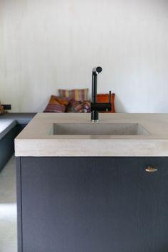 kitchen design concrete counter black smoked oak doors black kitchen tap