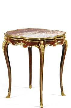 A near pair of gilt-bronze-mounted mahogany centre tables in the manner of François Linke<br>circa 1900   Lot   Sotheby's