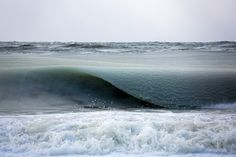 Giant Freezing Waves Infused with Ice Slowly Roll in off the Coast of Nantucket. Shot by Jonathan Nimerfroh