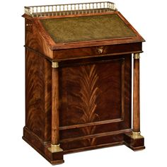 Elegant crotch mahogany veneered biedermeier style davenport with fitted interior, leather inset slope, and drawers to the side with hanging file storage flanked by columns with brass details. Feature