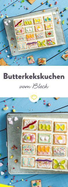 Garant für strahlende Kinderaugen: Butterkekskuchen vom Blech! Unten ein luftiger Rührteig, darauf ein cremiger Vanillepudding und on top 'viele bunte Smarties' …