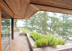 """""""Deep overhangs cut in a sawtooth pattern jut over expansive cedar decking"""""""