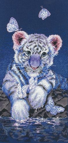 Beautiful whit tiger with butterflies probably on an advanced scale we need to find some more easy beginner projects to start with