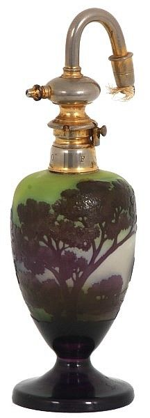 "Galle Cameo Cut Perfume Atomizer. Cameo cut glass perfume receptacle having a green background and purple scenic foreground, signed ""Galle"", in very good condition; has an atomizer nozzle signed ""Le Parisien, Bte S.G.D.G. Made in France"". 8.5 in. high. Weight: 1.25 lbs."