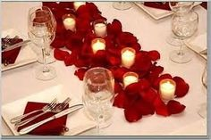 inexpensive centerpieces for tables- Maybe buy that Sam's club box of petals and go wild?