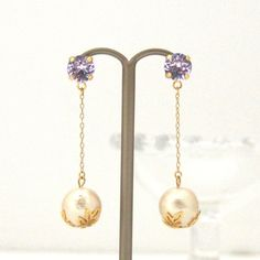 MiyabiGrace: Classy dangle cotton pearl earrings with violet Swarovski crystals, Titanium Earrings for Sensitive Ears, Bridal Earrings コットンパールピアス スワロフスキーピアス #cottonpearl #cottonpearlearrings #pearlearrings #swarovskiearrings #bridalearrings #weddingearrings #lightpurpleswarovskiearrings #コットンパールピアス #bridalpearlearrings #wedingpearlearrings #VioletSwarovskiCrystalEarrings #Earrings #Jewelry #accessory #DanglePearlEarrings #LightBeigeCottonPearlEarrings #MiyabiGrace #LightBeigePearlEarrings