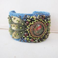 #beadwork Unakite Cuff Bracelet with Recycled Denim, Gold Tipped Leaves and Bead Embroidery. This is on the DYI section of pinterest. So study and sew or glue beads onto denim and then glue denim to wrap bracklet.