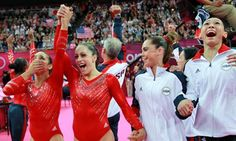 The USA artistic women's gymnastics team celebrate after winning gold ahead of Russia and Romania. Photograph: Ronald Martinez/Getty Images