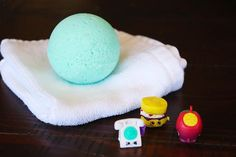 These bath bombs for kids are fun to make and all natural! They're easy enough for kids to make and have hidden toys inside each bath bomb!