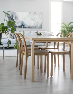 Woodnotes' Siro+ oak chairs together with  Artek's Alvar Aalto table