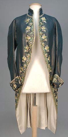 Formal coat, France, 1750-1775. Blue changeant silk, decorated in polychrome silk floral, embroidered buttons throughout.
