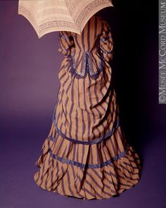 Day dress, Mlle. Chaillez, Montreal (?), ca. 1875. Cotton, silk satin, woolen lace, metal. Machine- and hand-sewn.