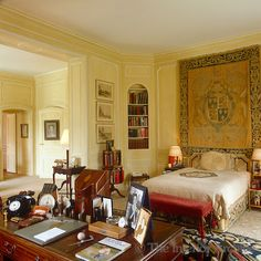 Every available surface, including a large antique mahogany desk, in the Duke of Windsor's bedroom is covered in photographs of the Duchess and other personal mementoes