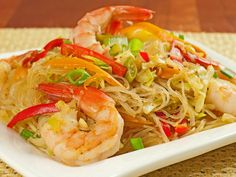Singapore-Style Noodles with Shrimp: A fast and easy stir fry of cellophane noodles, shrimp, cabbage, sweet bell pepper, garlic, ginger and yellow curry powder.