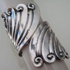 A vintage Mexican sterling silver clamper bracelet.