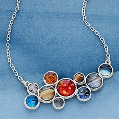 This bib necklace is a wearable tribute to the Sun and nine planets in our solar system.
