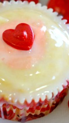 Strawberry Pudding Filled Cupcakes ~ White chocolate cupcakes filled with an easy DIY strawberry pudding and dipped in a white chocolate ganache.