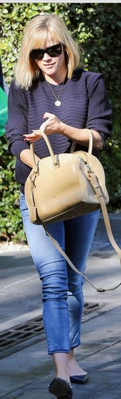 Reese Witherspoon: Purse – Saint Laurent  Jeans – Koral  Shoes – Valentino