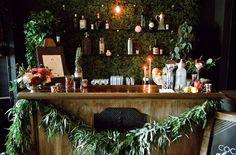 green garland bar set up| bachelorette mixology party
