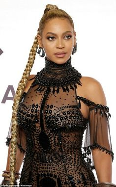 Beyonce Knowles Carter's  long ponytail hairstyle
