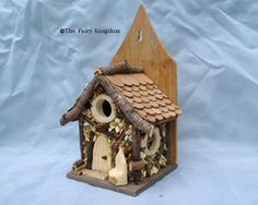 Functional birdhouse made to look like a fairy home - back opens for cleaning - the seat and door are a nice touch