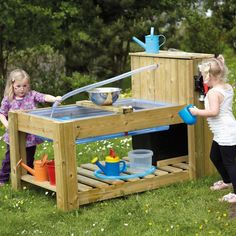 Buy Water Pump Station. A fantastic water trough with its own pump that does not require installation. The wooden frame houses a plastic water tray and features a water outlet for easy drainage. There is a lid to keep the tray clean and covered. The ledge is useful to balance buckets and tools (his sits across the water tray). The pump mechanism is easily used by the children to access water along the tubing. The water is housed in a container which can be filled directly or through a plu...