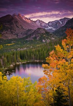 Bright orange and yellow aspen leaves provide a wonderful foreground for this classic view of Bear Lake and Longs Peak in Rocky Mountain National Park.