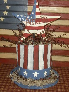 Uncle Sam Top Hat: Cute planter idea: Could be made from a painted coffee can, and a round piece of wood painted blue.