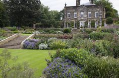 Yorkshire garden | Tom Stuart-Smith. View of planting up towards house. Planting with levels.