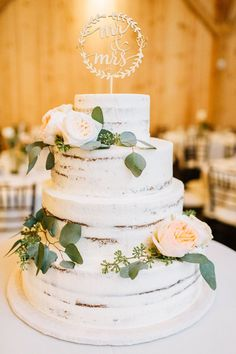 Floral Designer in Lancaster County, Pennsylvania. A simple, naked cake for this late fall or winter wedding, decorated with eucalyptus greenery and a mix of peach Juliet and white and blush O'hara garden roses. Blush Wedding Cakes, Wedding Cake Roses, Floral Wedding Cakes, Wedding Cake Rustic, Wedding Cakes With Cupcakes, Wedding Cake Designs, Wedding Cake Toppers, Blush Weddings, White Weddings