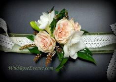 Wrist corsage of white freesia and peach roses #WildRoseEvents #corsage #weddingflowers #HarmonyChapel