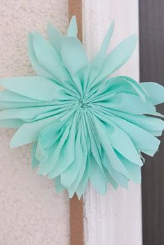 Fabric dahlia tutorial. How cute would this be for a baby headband! Garland for baby girl's nursery.