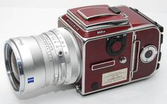 Hasselblad 503 CW V Series Anniversary Camera. 60 Years Cooperation Zeiss Lenses, in Burgundy colour Skin wrap