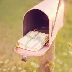 very pretty pink vintage post box :) with sweet letters inside.... love it!