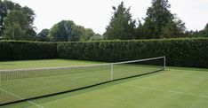 Someday, we will have a sunken grass court with a hedge around it - simple and stunning!