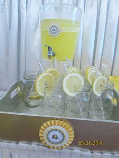 Lemonade and mason jars at a yellow and gray elephant baby shower party! See more party planning ideas at CatchMyParty.com!