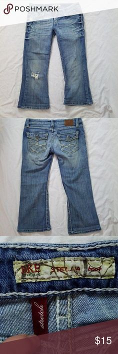 BKE Stella Capri Factory distressed. These were originally bootcut jeans, but were hemmed to make really cute capris. You can not tell they were hemmed without close inspection. I've posted pictures of the hem inside and out so you can see for yourself. These still have lots of life left in them. BKE Pants Capris
