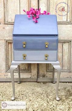 A charming and neat little writing bureau, painted in an ombré effect of camel beige tones, to pretty violet blue. Polished brass drop pulls elegantly finish it off. The inside is gleamingly cloud- like in stippled gold, beige and tones of indigo https://www.facebook.com/groups/thebespokefurniturecollection
