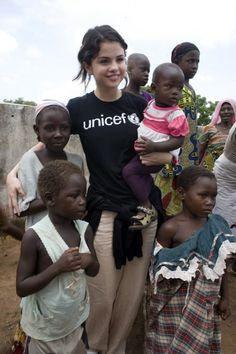 Selena Gomez, UNICEF Ambassador,  in Ghana, 2009 she helps out that is another reason i like her as a sister