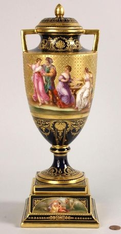 Royal Vienna Porcelain Coverd Urn. Cobalt blue base with ornate hand painted decoration and large panels depicting Achilles with maidens and the robbery of Europa. Four small decorative panels at base