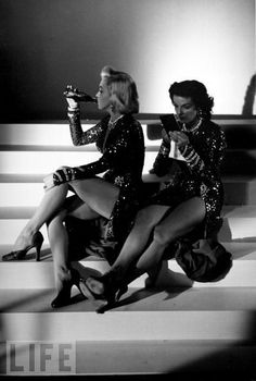 """Marilyn Takes a Break  Monroe and her """"Gentlemen Prefer Blondes"""" costar Jane Russell, in matching gowns designed by Travilla, relax between photos."""
